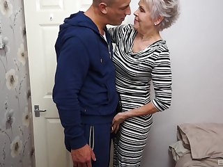 Mature short haired granny Lady Sextacy gets on her knees to blow cock