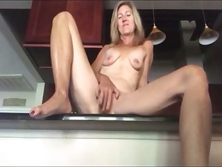 my tow-headed stepmother orgasms in our kitchen omg