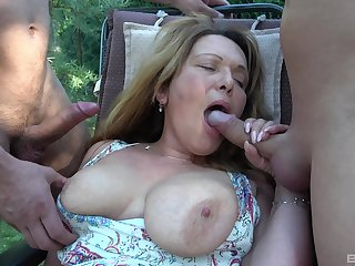Mature amateur gets fucked in a threesome in the with regard to yard