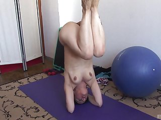 Solo mature amateur gets unadorned during her yoga session and masturbates