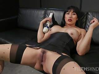 Asian whore sticks large toys in both holes not later than a rare solo