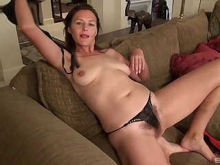 Mature amateur gets naked together with spreads her legs far masturbate