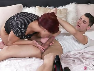 Redhead milf and her toyboy lover